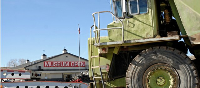 A Euclid 302LD Dump Truck arrives Tuesday at the Wyman Museum. The truck will be put on display just south of the museum.