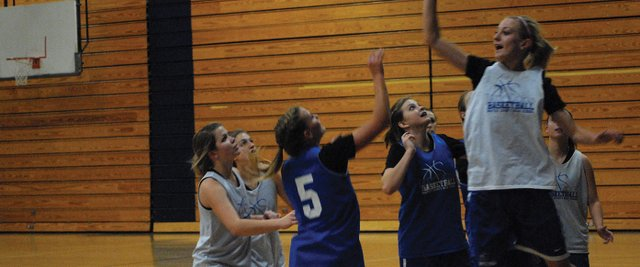 Bailey Hellander (right, in white) goes up to block teammate Jazmine Swindler&#39;s shot during a practice in the Moffat County High School gym. All three girls teams from MCHS played three games over the weekend in Vernal, Utah.