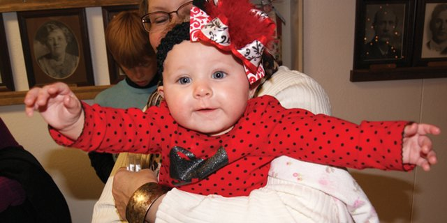 Kylee Hammer, six months, takes in all the sights Thursday night at the Festival of Trees.
