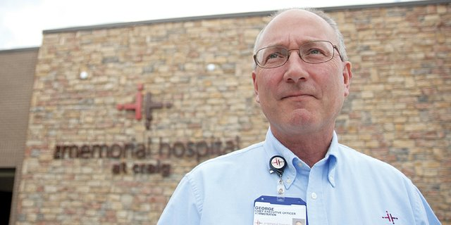 The Memorial Hospital CEO George Rohrich, pictured above in front of the hospital's main entrance, resigned Friday. Rohrich, who had helped steer the hospital to its new location west of town, had served as CEO for about seven years.