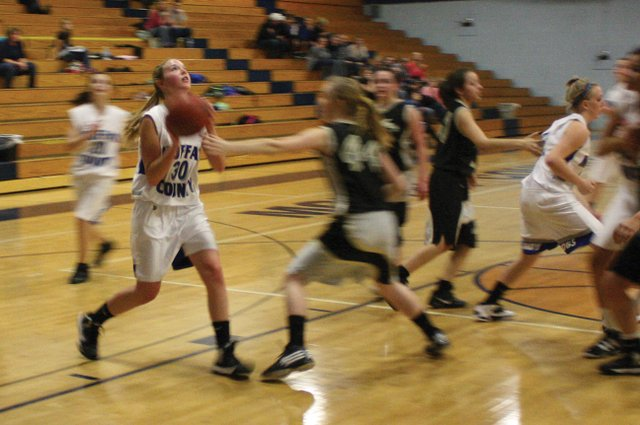 Kaitalyn  Reed, a freshman at Moffat County High School, drives to the basket Tuesday afternoon at MCHS. Reed finished the game with six points and the Bulldogs rolled to a 69-8 victory.