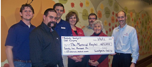 Employees of Peabody Energy present Friday officials of The Memorial Hospital in Craig and members of The Memorial Hospital Foundation with a $25,000 donation for Electronic Medical Record software for the emergency room department at TMH. Accepting on behalf of the hospital were Bryan Chalmers, TMH CFO; Bonnie Hampton, TMH Foundation vice chairperson; and Kim White, ED manager.