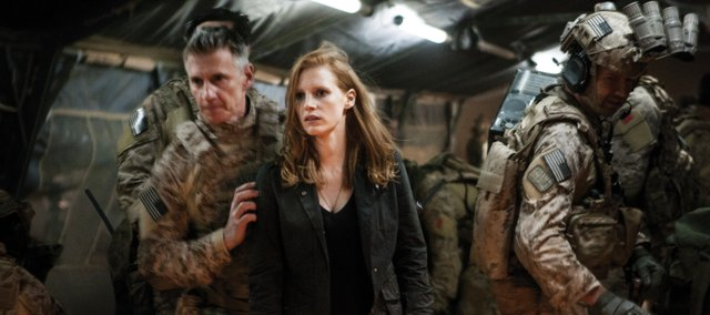 CIA agent Maya (Jessica Chastain) takes in the awe of the moment following a significant military operation in Zero Dark Thirty. The movie is about the American governments efforts to find al-Qaida leader Osama bin Laden.