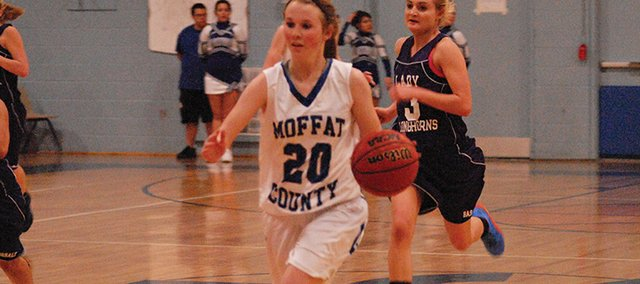 Tori Snyder gets out on the break after making a steal during the Moffat County-Basalt basketball game Friday in Craig. The Bulldogs won, 72-28.