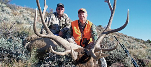 Chris Jurney, left, of Craig, and Rick Callison, of Denver, pose with a bull elk harvested in game management unit 201 in northwestern Moffat County. Last week Jurney was honored as the Colorado Outfitters Association's 2012 Outfitter of the Year.