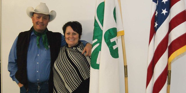Shane Wilson and his wife, Shelly, stand together at the Moffat County extension office. The Wilson's have started a program in honor of Shane's late father, Homer, that will ward scholarships to local youths involved in 4H or Future Farmers of America.
