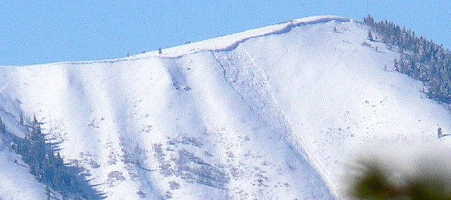 Steamboat Springs avalanche expert Art Judson photograph a large soft-slab avalanche in a gully on the Sleeping Giant, west of Steamboat Springs, on Saturday.