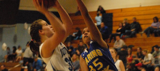 Kori Finneman puts up a transition basket against Roaring Fork's Autumn Grandberry on Saturday in the MCHS gym. Finneman finished with 16 points as the Bulldogs avenged their only league loss with a 65-44 win.