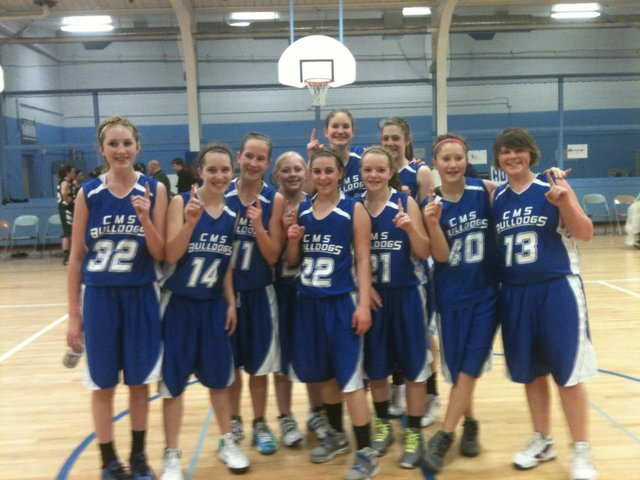 The Craig Middle School eighth-grade girls team celebrates after winning the district championship in Craig on Saturday. The eighth-graders beat Steamboat Springs and Rangely to win their second straight title. 