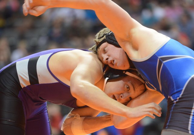 Moffat County junior Jesse DeMoor wrestles Saturday in a consolation match at the Class 3A wrestling tournament in Denver. DeMoor lost the match and fell from the competition.