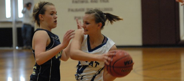 Moffat County junior Jazmine Swindler tries to pass out of pressure during the Bulldogs' game against Olathe on Saturday in Palisade. In a tight game, Moffat County came away with a 46-41 victory and won the district championship.