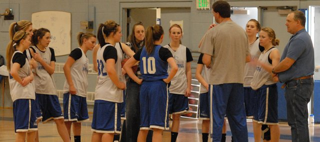 Moffat County High School girls basketball coach Matt Ray talks to the team at practice Tuesday in the gym. Moffat County is hosting regional games this weekend and are preparing in much the same way they have the second half of the season.