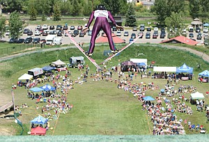 Steamboat Springs Nordic combined skier Koby Vargas soars over the crowd during the 2016 Jumpin' and Jammin' event at Howelsen Hill in Steamboat Springs. Hundreds packed into the landing flats and along the jump to watch the event.