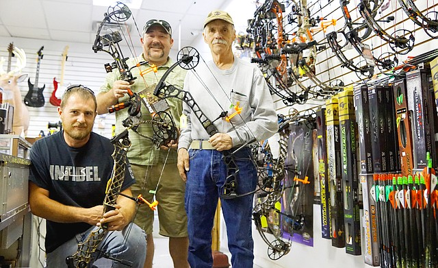 P.J Nichols hangs with his staff at Northwest Colorado Pawn Shop where they provide archery supplies.