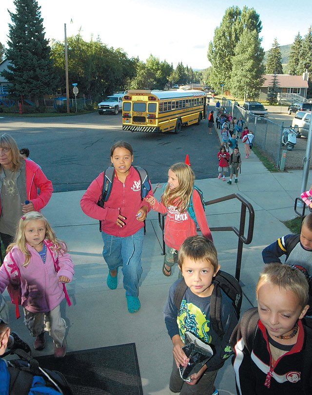 Soda Creek Elementary School students enter school Thursday morning to start another day of learning. In November, Steamboat voters will decide whether to fund a large-scale elementary school building initiative, which has a cost of nearly $30 million, spread over 20 years and funded by local property taxes.