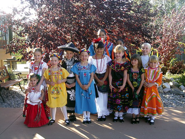Pictured here are the dancers from last year's Mexican Independence Day celebration. The 12 girls this year will be wearing traditional Mexican dresses from these nine different states: China Poblana, Guerrero, Charra, Veracruz, Oaxaca, Sonora, Jalisco, Adelita and Chiapas.