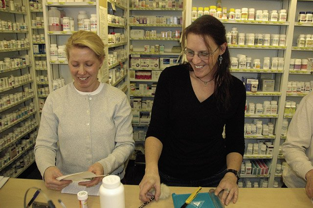 Lyon's Corner Drug staff pharmacist Tahnee Miller, left, prepares prescriptions with technician Vickie Szumski on Wednesday, a day after Wal-Mart began a $4 generic prescription drug program in Colorado.