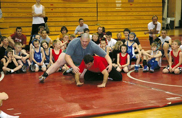 Two-time Olympic medalist Rulon Gardner works with Steamboat Springs wrestling coach Sean McCarthy to show 75 wrestlers of all ages several techniques and moves during Thursday's clinic at Steamboat Springs High School.