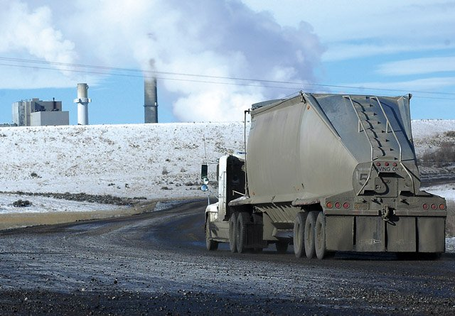 A coal truck heads toward the Hayden Power Station on Tuesday. Routt County has hired a consultant to help it negotiate a proposed rail line that would eliminate the use of coal trucks on Routt County Road 27 from Twentymile Coal Co.