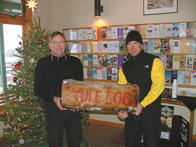 Steamboat Springs residents Tom Whiddon, left, and Scott Schaffer hold the Yule Log on Thursday. They were the first to find the log using clues provided by local historian Jayne Hill.