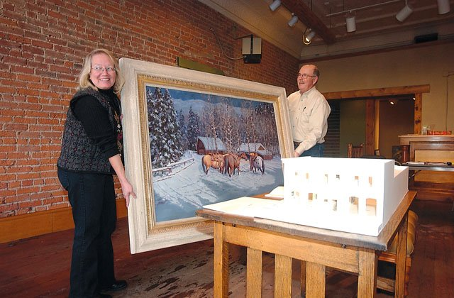 Shirley Stocks and Rod Hanna carry a painting to be hung at the Steamboat Art Museum, 807 Lincoln Ave., on Thursday. The museum opens to the public today.