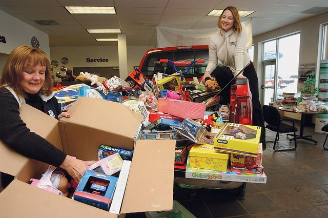 Linda Taylor, left, unloads a box of donated toys with the help of Lisa Idzahl. For the 10th straight year, the Toys for Tots drive in Routt County was a resounding success.