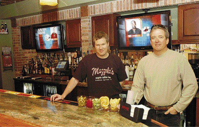 Mazzola's owner Rex Brice, left, and Holiday Inn owner Scott Marr partnered to open Rex's American Grill and Bar. The restaurant has already become a locals' favorite, and Marr and Brice say they have been surprised by the response since the restaurant opened Dec. 1.