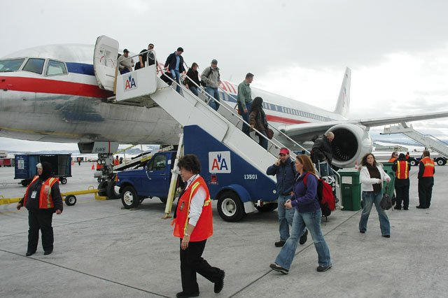 American Airlines passengers deplane Thursday at Yampa Valley Regional Airport in Hayden. A second wave of Steamboat Springs visitors has begun to arrive, and local lodging properties expect to remain busy through the weekend.