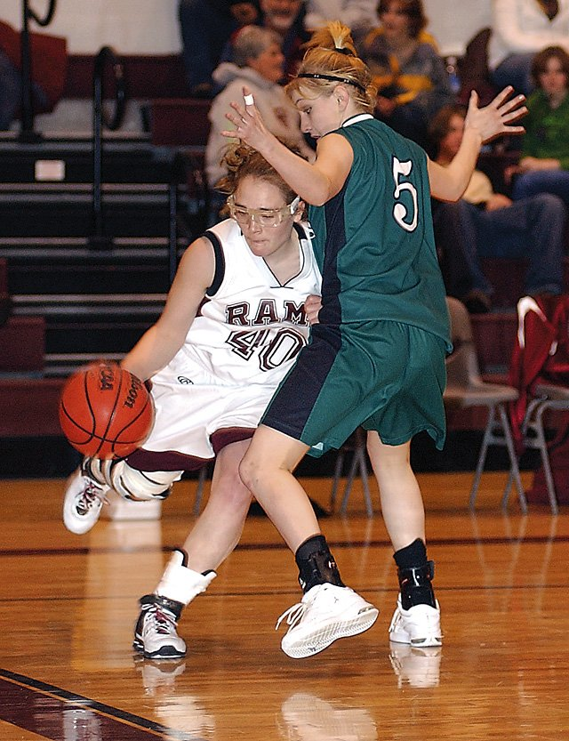 Soroco Rams Glenda Long drives on her Plateau Valley opponent toward the basket drawing the foul. Saturday the Rams lost 70-39 at home with their next game Tuesday against county rivals the Hayden Tigers at home with girls varsity at 5:30  and boys varsity at 7 p.m.  