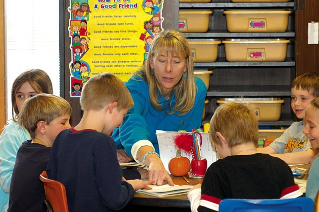 Substitute teacher Sandi Crouch works with second-graders at Strawberry Park Elementary School on Thursday. Steamboat raised the pay for substitutes, which has helped with its shortage, but administrators from Steamboat, Hayden and South Routt said they could always use more subs.