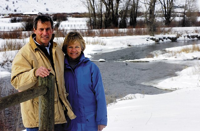 Michael and Suzy Holloran stand on their property along the Yampa River on Colo. Highway 131 south of Steamboat Springs. Michael Holloran has publicly questioned a watershed protection ordinance currently considered by the Steamboat Springs City Council.