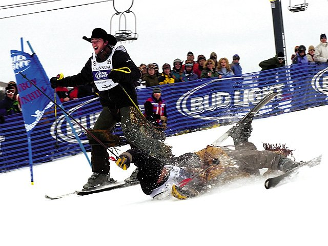 Kelly Timberman of Mills, Wyo., passes Shannon Jacoby of Malakoff, Texas, during a previous Cowboy Downhill event. This year's festivities begin at 1:30 p.m. Tuesday on Headwall and feature PRCA cowboys and the Denver Broncos cheerleaders.