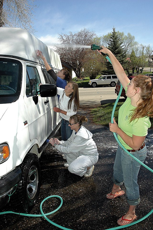Steamboat Springs High School Leadership Class members from right, senior Molly Willard, sophomores Taylor Miller-Freutel and Nicole Rende and senior Lucy Froemmling clean and wash vehicles for Horizons during the 21st annual Day of Caring in May. The event was organized by the United Way.