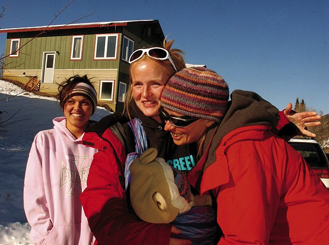 New home owner Corine Schweikert receives a hug from Lynne Paschal on Wednesday during a ribbon-cutting celebration for six families that participated in a self-help housing program funded by the Yampa Valley Housing Authority and a grant from the U.S. Department of Agriculture Rural Development. The homes are located on Grandview Street above the ice rink in Oak Creek.