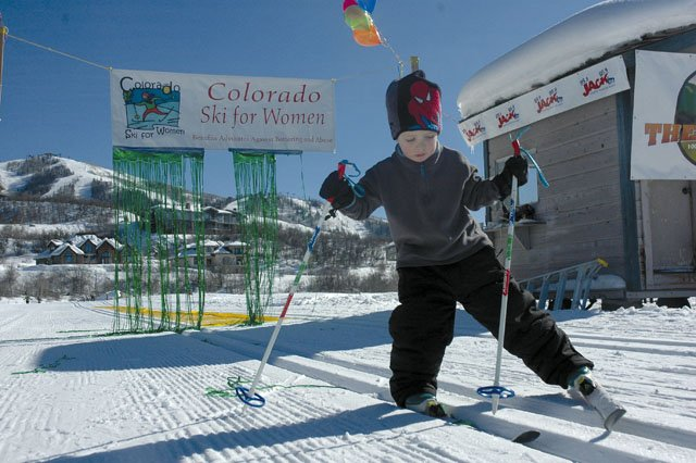 "Tommy Mewborn, 3, gets his skis on track Sunday at the Steamboat Ski Touring Center. Tommy completed a 5-kilometer course to help raise funds for Advocates Against Battering and Abuse. More than 100 people participated in Sunday's event, which had a ""Winter Land of Oz"" theme complete with costumes and a yellow brick road at the finish line."