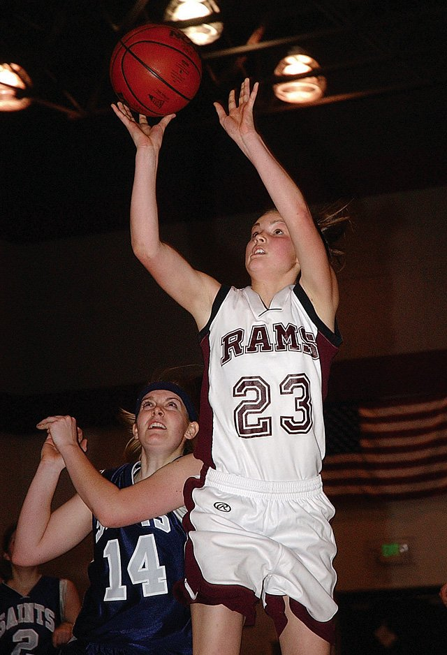 Soroco High School sophomore Sarajane Rossi goes up for a shot against Vail Christian Saints senior Danielle 