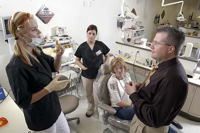 Jim McCreight, right, talks with students at the Las Vegas Institute for Advanced Dental Studies. McCreight, along with his wife and partner, Wendy, have started the McCreight Smile Foundation. The Smile Foundation is designed to provide victims of domestic violence with dental care.