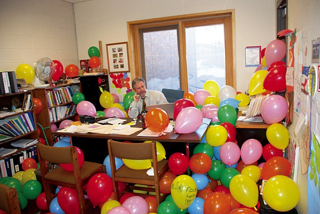 Strawberry Park Elementary School Principal Mark MacHale returned from an out-of-town reading conference Monday morning to find his office overflowing with balloons. And it wasn't even his birthday.