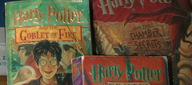"Kaleigh Cutler says she loves reading the Harry Potter series because of their fantasy and mystery. She has read all of the Harry Potter books released to date multiple times. The seventh book in the series, ""Harry Potter and the Deathly Hallows,"" is scheduled to be released July 21. The fifth movie in the series, ""Harry Potter and the Order of the Phoenix,"" is scheduled to open Wednesday."