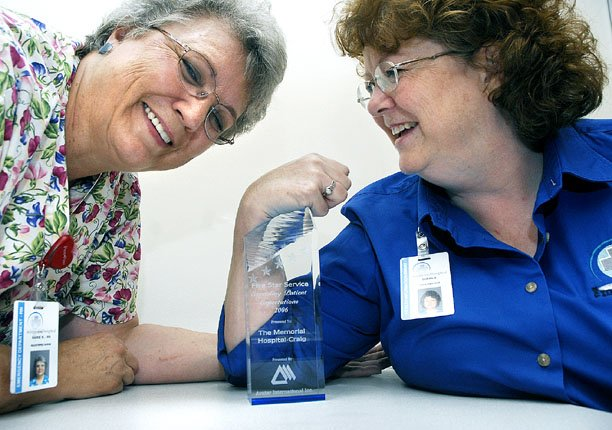 Emergency room nurse Marie Kettle, left, and medical records supervisor Susan Erikson pose with The Memorial Hospital's five-star 2006 Exceeding Patient Expectations award they received this week from Avatar International. Hospital officials said the staff - those who work one-on-one with customers - deserve the credit.