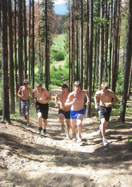 Jarred Blevins, from left, Jesse Breslin, Mike McNicol, Josh Classen and Corey Wojtkiewicz run up a trail during a workout Friday.