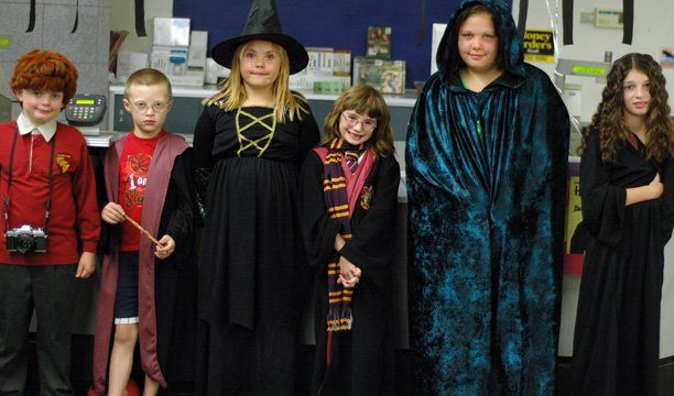 Children line up at K-Mart on Friday night for a Harry Potter costume contest. From left are, Riley O'Leary, Conner Perkins, Cheyenne Harmon, Marissa Butler, Jordan Harmon and Brynnae Demster.