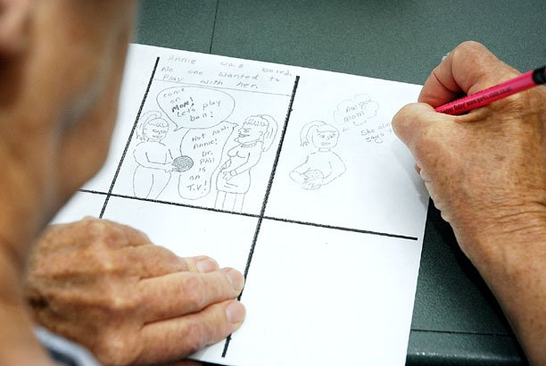 "Verda Lichtenhahn, of Craig, works on a progressive cartoon during ""Toon Time,"" an Aging Well program offered during Wellness Wednesdays at the American Legion Post 62 facility. ""Our cartoons are turning out to be pretty silly,"" Lichtenhahn said."