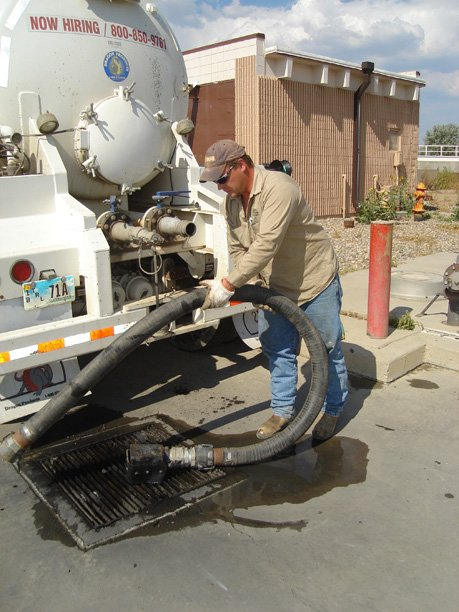 Patrick Maki with HP Rentals of Riverton, Wyo., off-loads 5,460 gallons of sewage at the Craig Wastewater Treatment Facility on Monday afternoon. Maki has been making six runs each week to Craig from a man-camp north of Baggs, Wyo., hauling wastewater for disposal.