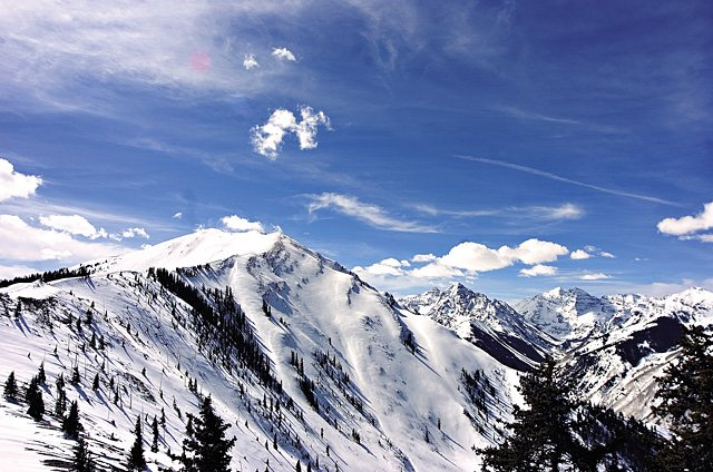 The breathtaking beauty of the snow-covered Maroon Bells, visible from the top of the Aspen Highlands ski area, is at risk of diminishing in the face of strong warming trends forecast by various global climate experts.