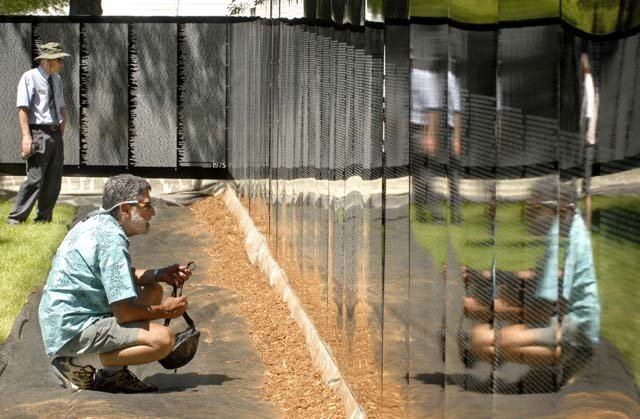 Visitors examine the Moving Wall during its recent visit to Missoula, Mont. The Moving Wall, a replica of the Vietnam Veterans Memorial in Washington, D.C., will be on display from Thursday through Aug. 13 at Loudy-Simpson Park. Veterans say the wall's display will pay homage to all those who lost their lives in the conflict.