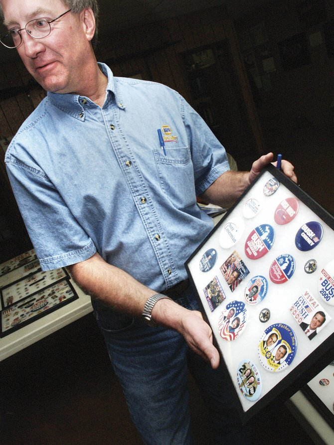 John Ponikvar shows off his collection from the 2000 election.  All of his buttons are organized by the year of the election. Ponikvar focuses on Republican candidates.