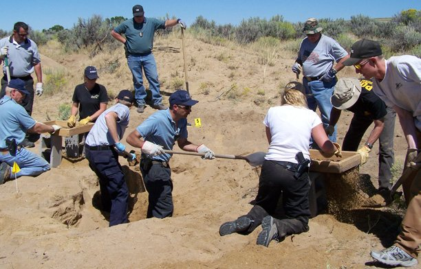 Authorities dig Saturday for the body of Cynthia Hankins/Runnels, a missing Craig woman who was last seen June 3. Her body was found on a gold mining claim three miles south of the Wyoming border. Hankins' husband, Terry Hankins, was arrested on suspicion of murdering his wife.