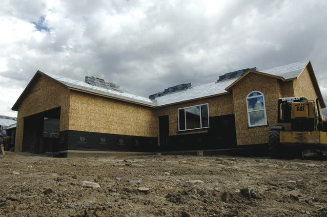 A house on Sixth Street and Riford is under construction. There currently is a shortage of new homes being built in the housing market, according to local real estate agents.