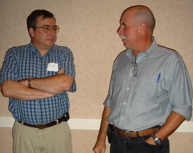 Jim Dodd, left, mining industry consultant, talks with Mike Gush of Rio-Tinto's Colowyo Mine at the Northwest Colorado Energy Producers Association meeting Thursday evening at the Holiday Inn of Craig. A presentation covered the combustion-improvement project at Hayden Station.